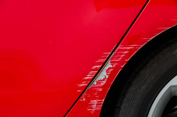 accident - smashed body of red car - dent stock pictures, royalty-free photos & images