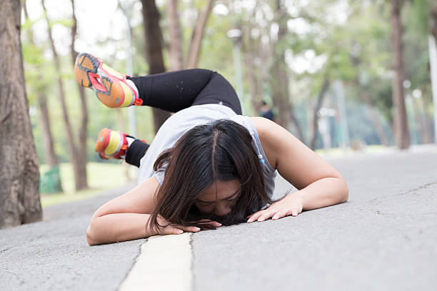 Accident. stumble and fall while jogging - foto de stock