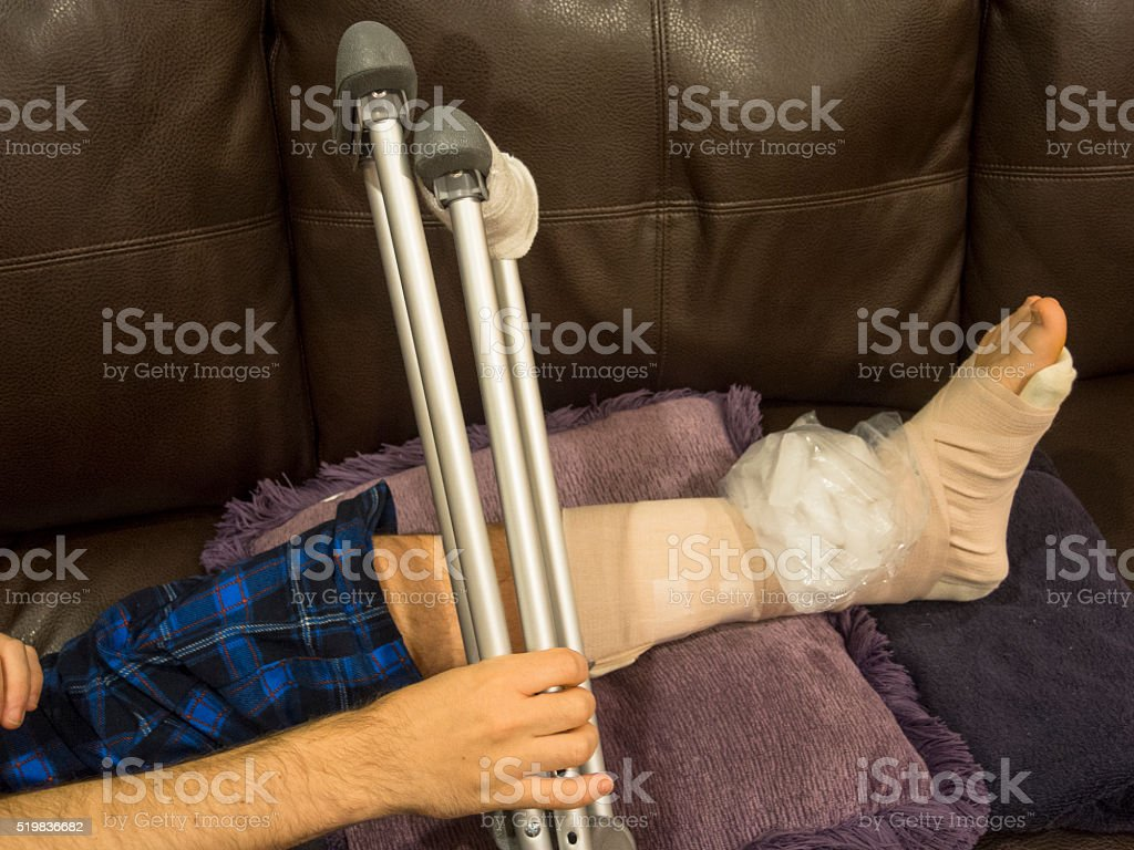 Accident Victim Grabbing His Crutches stock photo