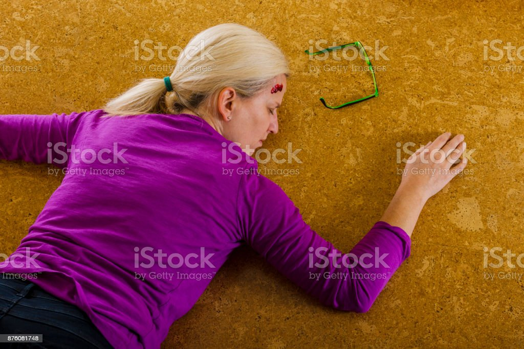Accident - woman falling down at home stock photo