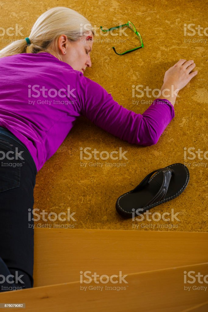 Accident - woman falling down the stairs at home stock photo
