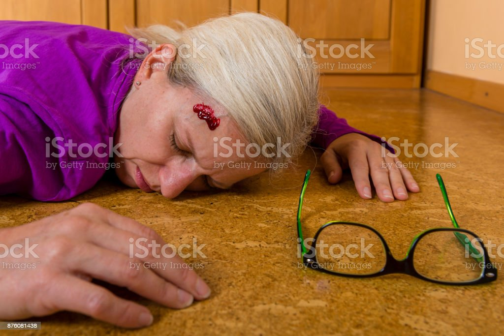Accident - woman falling from a ladder at housework stock photo