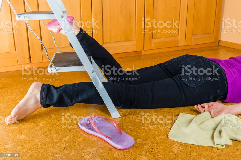 Accident - woman falling from a ladder stock photo