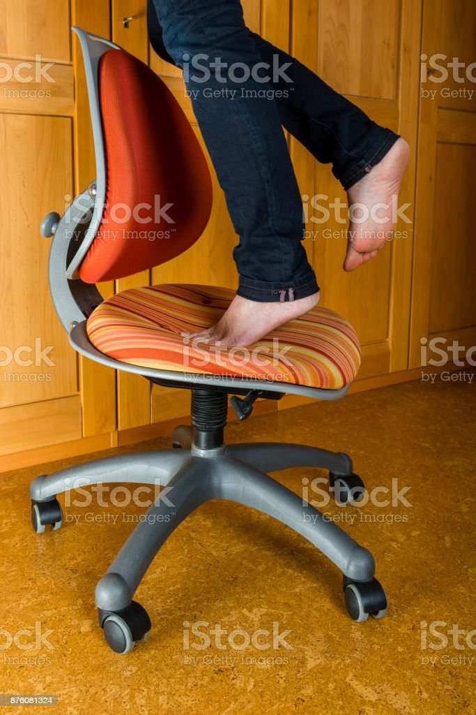 Accident - woman falling from a stool at home stock photo