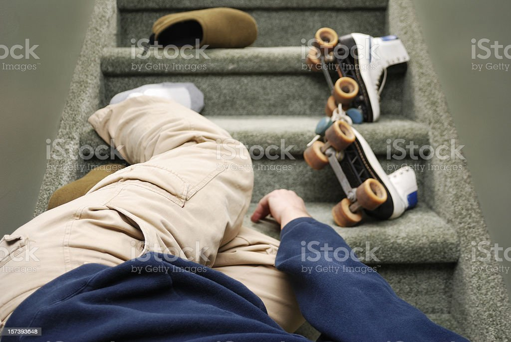 Accidents in the Home, a man falls down stairs stock photo