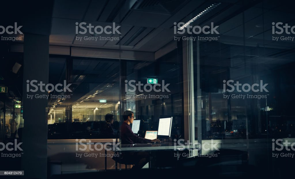 Accomplishing his goals no matter the time stock photo