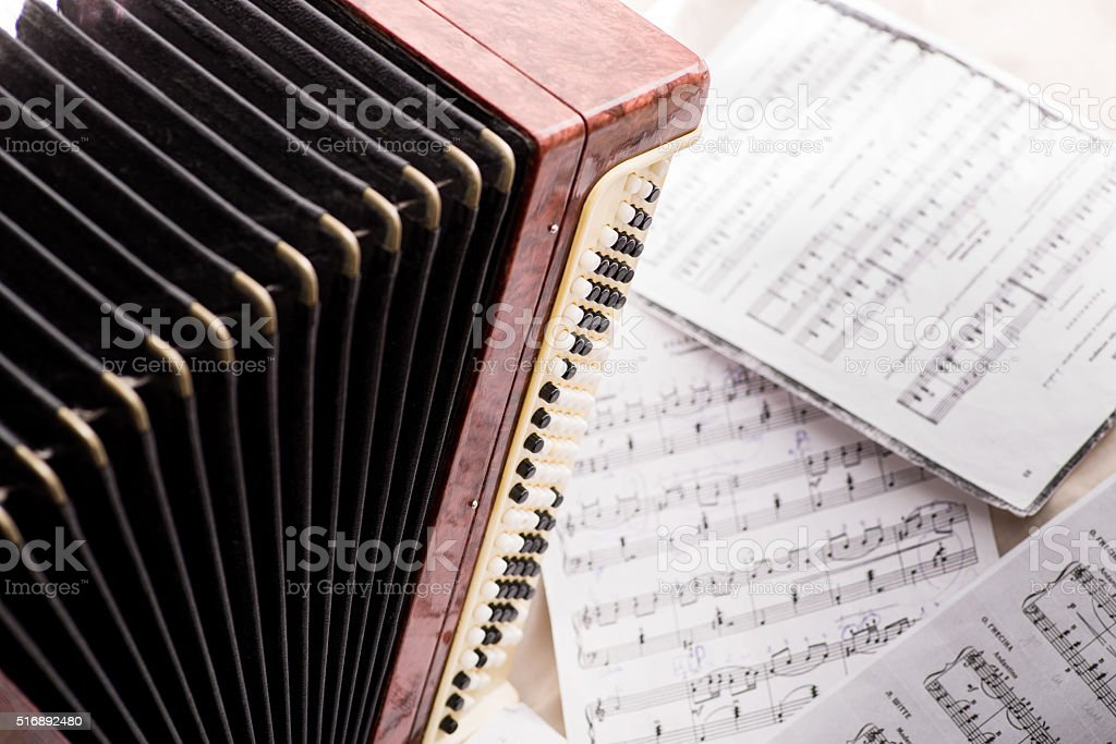 accordion and notes stock photo