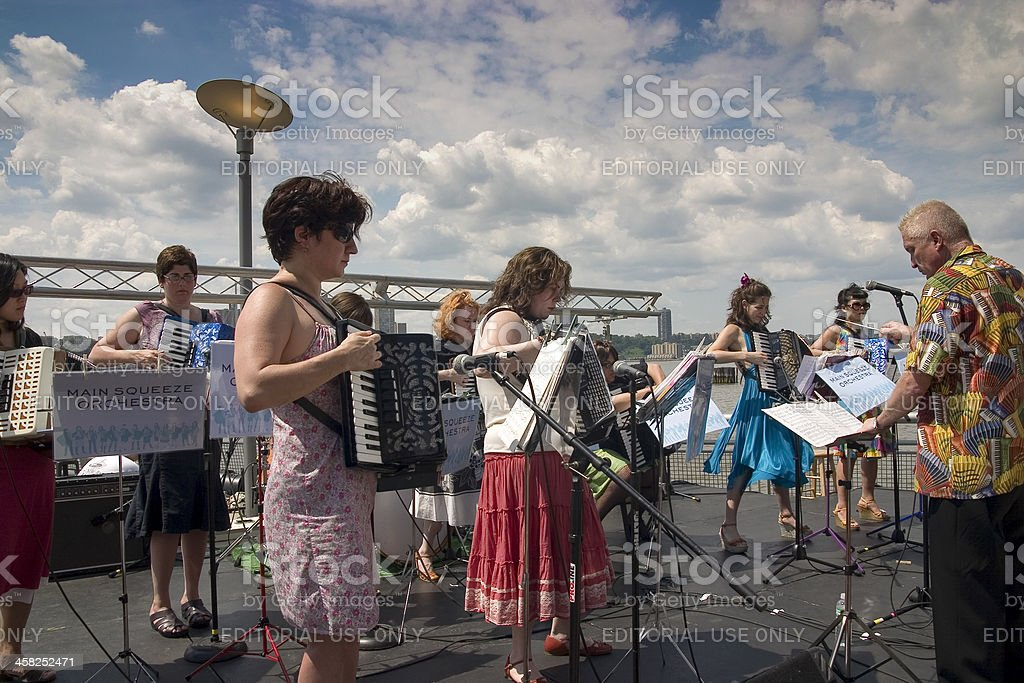 Accordion orchestra in the park royalty-free stock photo