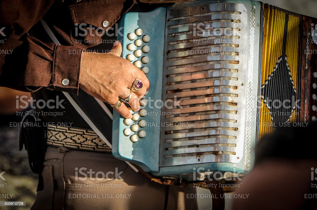 Accordion player by Mariachi stock photo