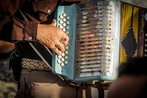 accordion player by mariachi - accordion stock photos and pictures