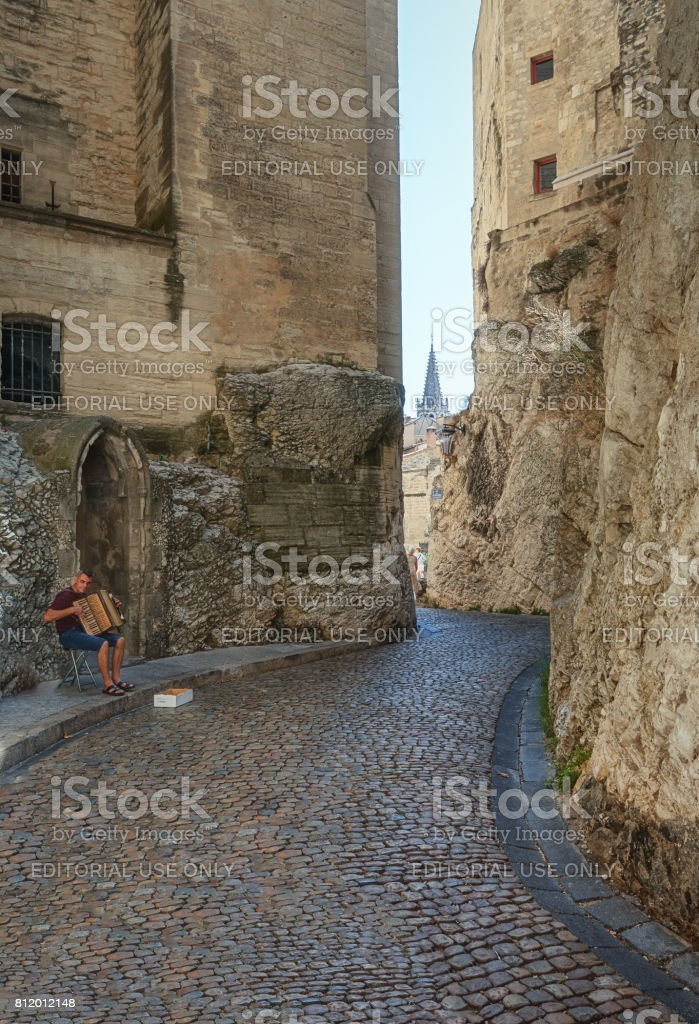 Accordion player in a narrow street in Avignon stock photo