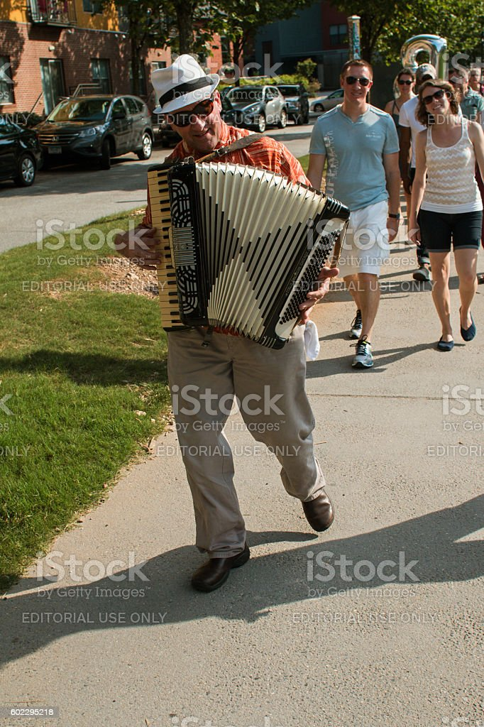 Accordion Player Leads Spectators To Ballet Performance On Atlanta Beltline stock photo