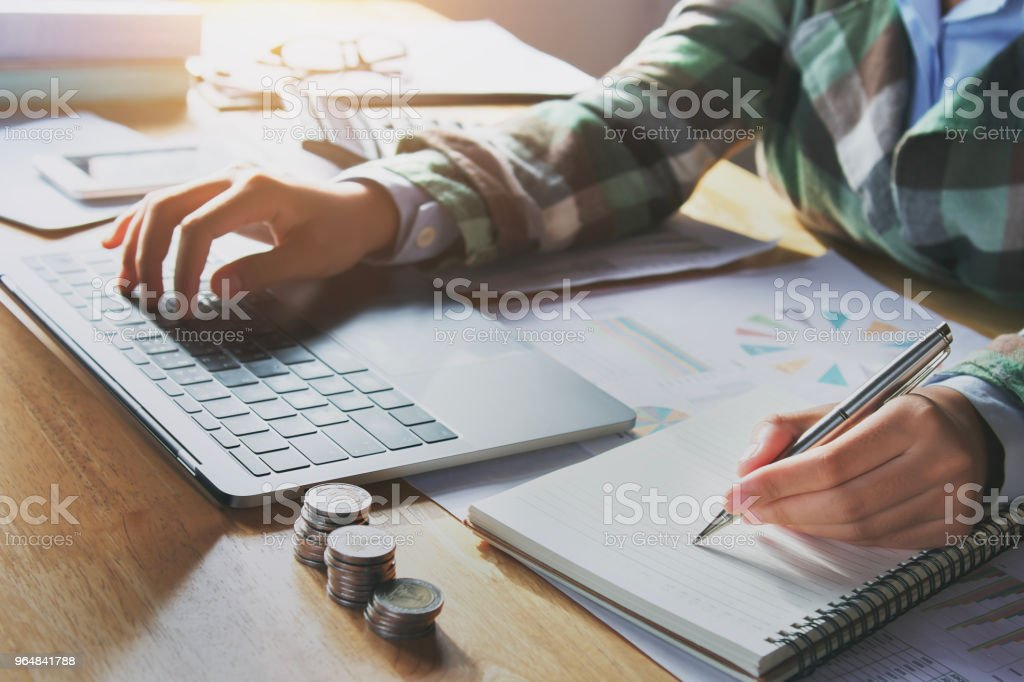 accountant analyzing finance on laptop in office. concept accounting royalty-free stock photo