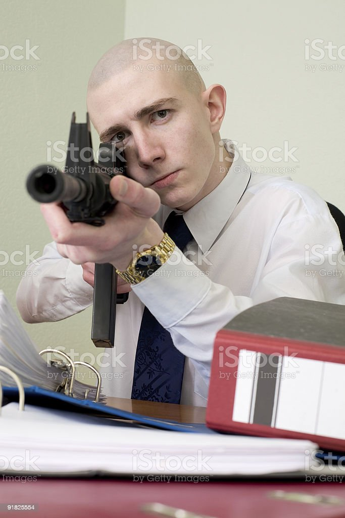 Accountant armed with a rifle stock photo