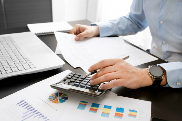 Accountant at work. Concept of budget and savings stock photo