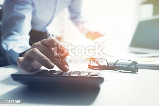 istock Accountant calculate tax information 1128972661