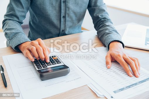 istock Accountant calculating income and examining report_tone 662607360