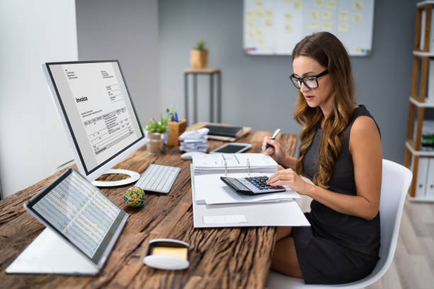 Accountant Calculating Tax At Desk stock photo