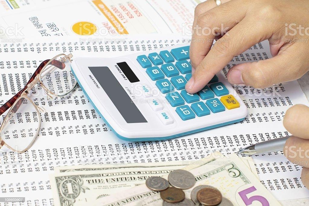 Accountant Checking A Spreadsheet stock photo
