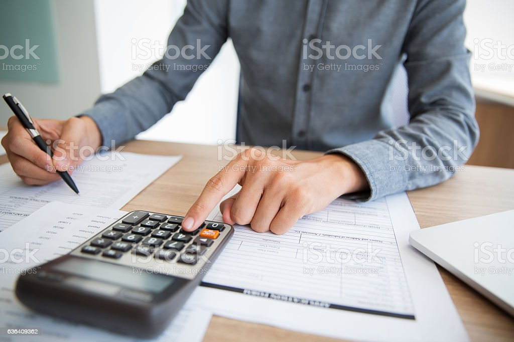 Accountant examining financial report stock photo