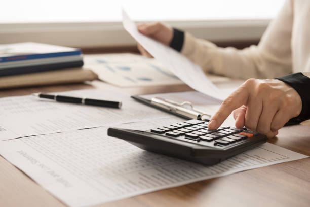 accountant financial bookkeeper inspector calculated and checking balance account. accounting and auditing concept. calculator stock pictures, royalty-free photos & images
