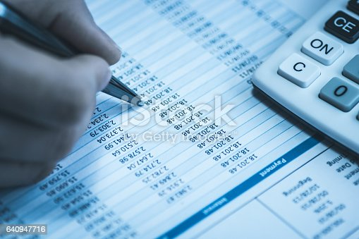 istock Accountant in accounting. Spreadsheet with human hand holding pen and calculator in business blue. Stock balance sheet. Concept of corporate finance department. 640947716