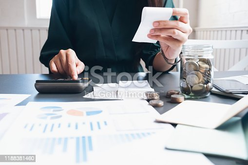 490632340istockphoto Accountant or banker calculate the cash bill. 1188381460
