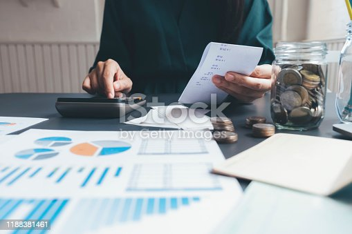 490632340istockphoto Accountant or banker calculate the cash bill. 1188381461