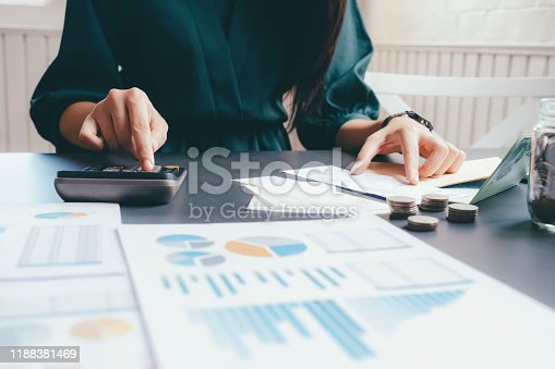 490632340istockphoto Accountant or banker calculate the cash bill. 1188381469