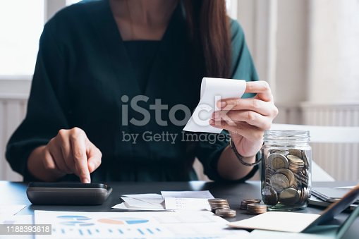 490632340istockphoto Accountant or banker calculate the cash bill. 1188393618
