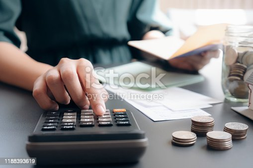 490632340istockphoto Accountant or banker calculate the cash bill. 1188393619