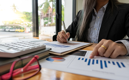 accountant or banker calculating or checking balance. Bookkeeper or financial inspector making financial report. Home finances, investment, economy, saving money or insurance concept