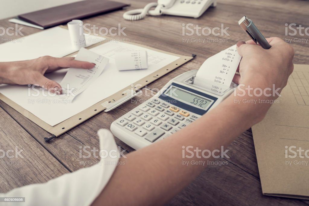 Accountant or businesswoman balancing the books stock photo