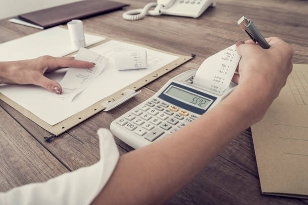 accountant or businesswoman balancing the books - receipt stock photos and pictures