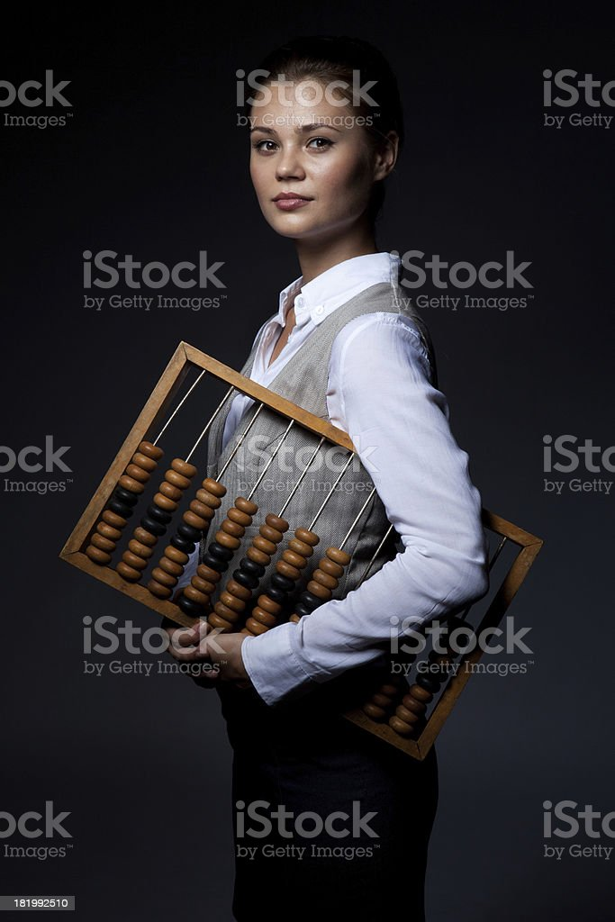 Accountant with old-fashioned adding machine royalty-free stock photo