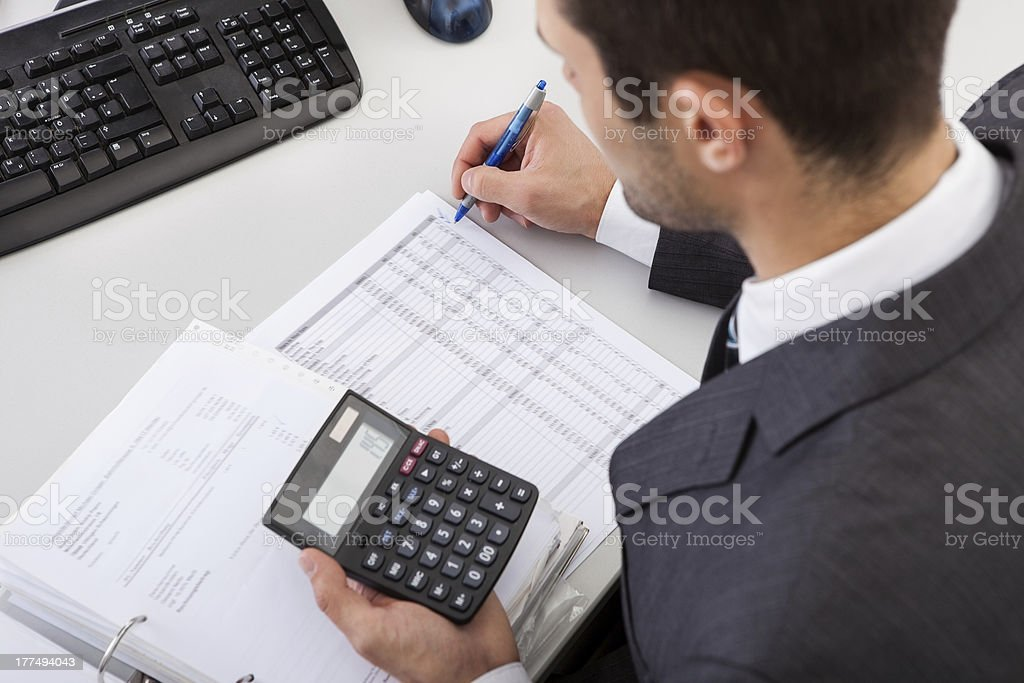 Accountant working at the office royalty-free stock photo
