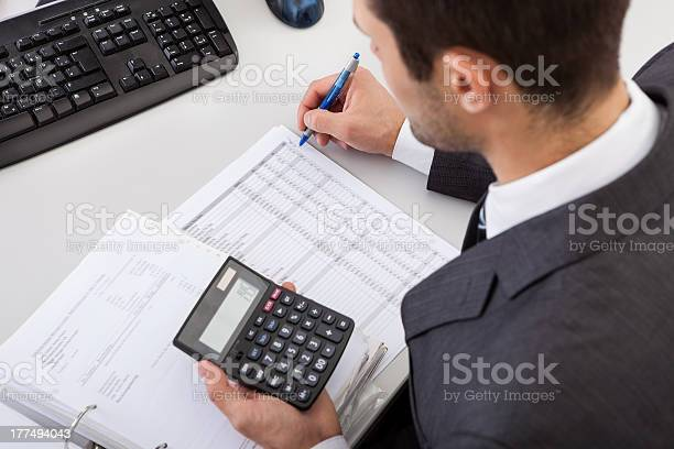 Accountant Working At The Office Stock Photo - Download Image Now
