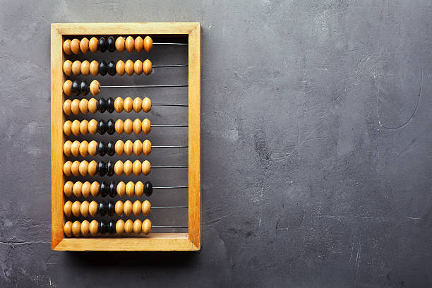 accounting abacus on gray textured background - abakus bildbanksfoton och bilder