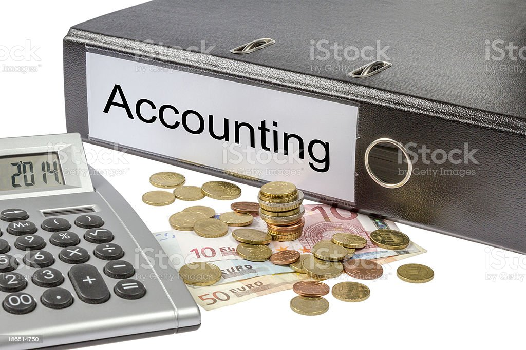 Accounting Binder Calculator and Currency royalty-free stock photo