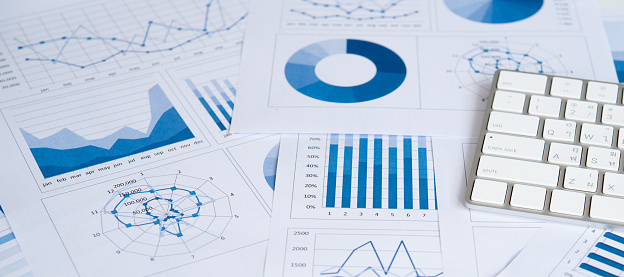 Business graphs and charts report with keyboard computer on desk of financial advisor. Financial abstract concepts.