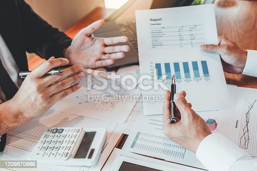 Accounting Business Team meeting Planning Strategy Analysis investment and saving concept. meeting discussing new plan financial graph data