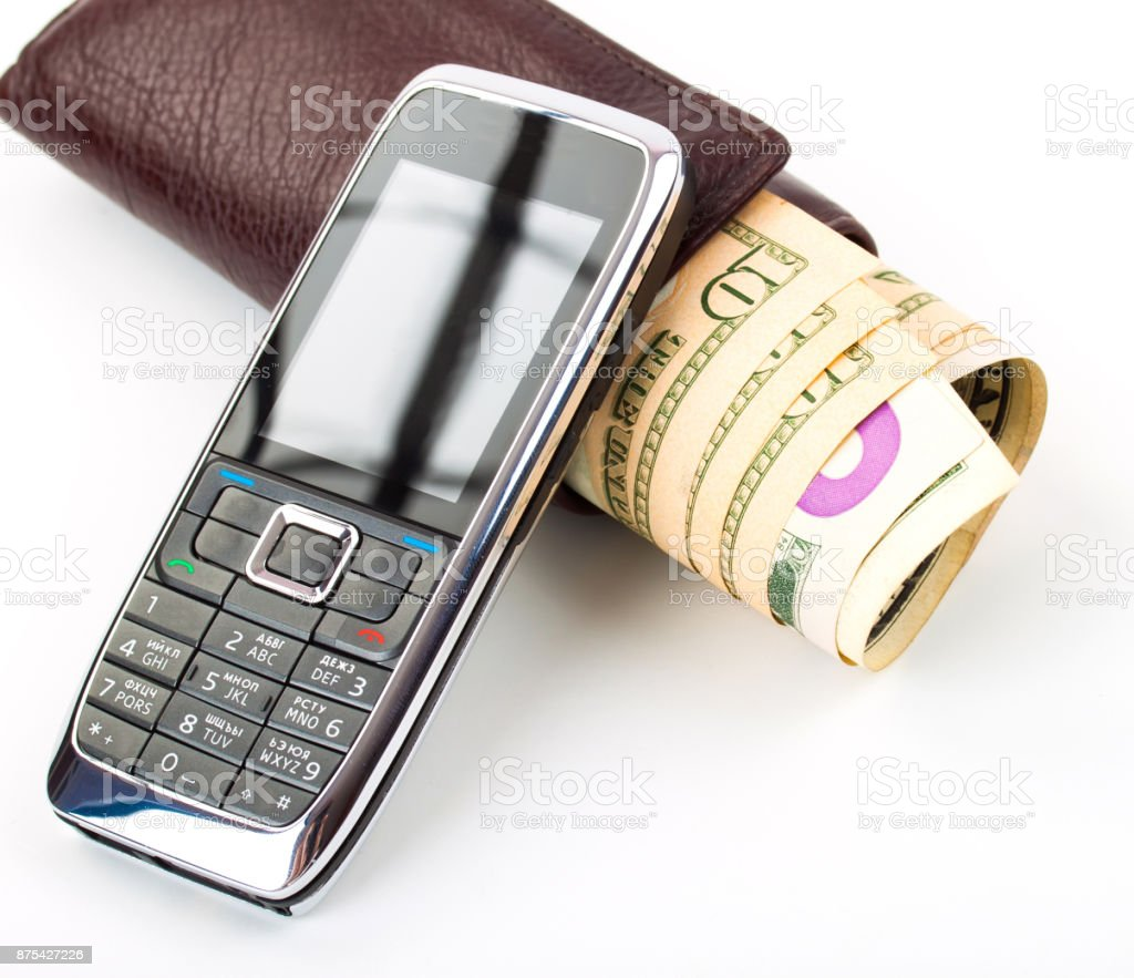 accounting. cash money, purse and mobile phone on table. stock photo