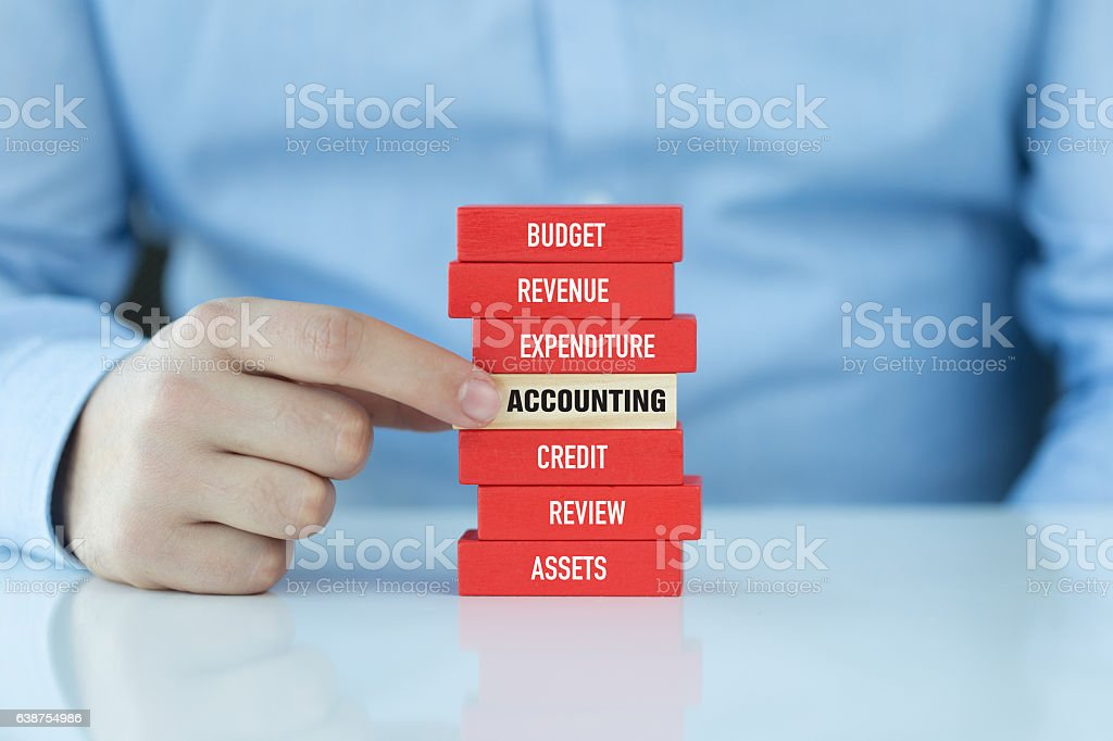 Accounting Concept with Related Keywords on Wooden Blocks stock photo