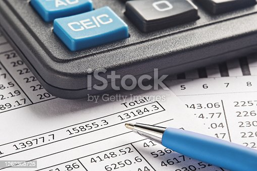 490632340 istock photo accounting document with pen and calculator. Concept of banking, financial report and financial audit. 1262368725