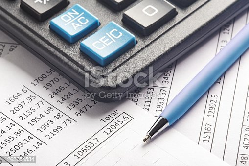 490632340 istock photo accounting document with pen and calculator. Concept of banking, financial report and financial audit. 1263054534