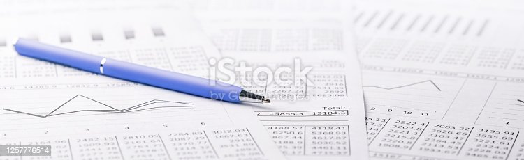 490632340 istock photo Accounting document with pen and checking financial chart. Concept of banking, financial report and financial audit. 1257776514