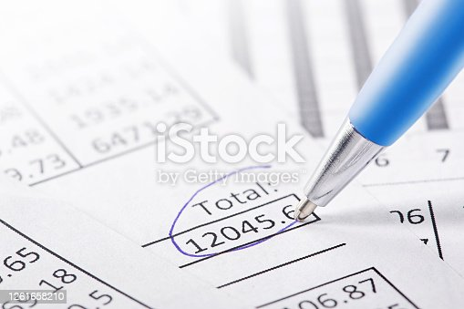 490632340 istock photo Accounting document with pen and checking financial chart. Concept of banking, financial report and financial audit. 1261658210