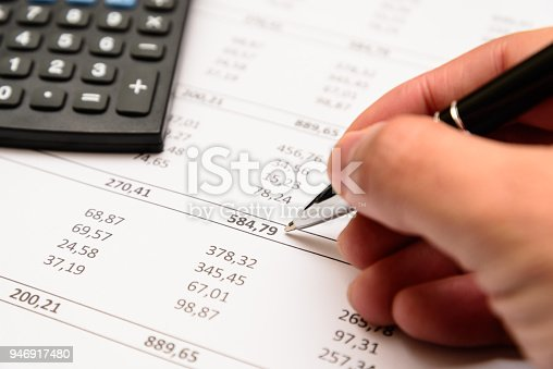istock Accounting equipment in use. 946917480