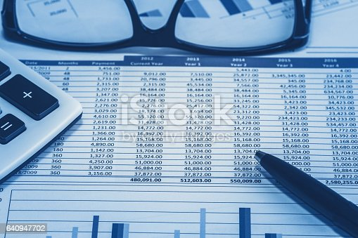 istock Accounting financial bank banking account stock spreadsheet data for accountant  with glasses pen and calculator in blue analysis analyst analyzer 640947702
