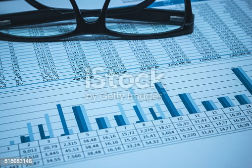 istock Accounting financial banking account spreadsheet data with glasses in blue 515683146